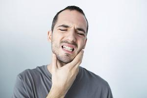 man holding jaw from pain | emergency dentistry mount waverley vic