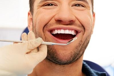Happy man getting dental exam in mount waverley